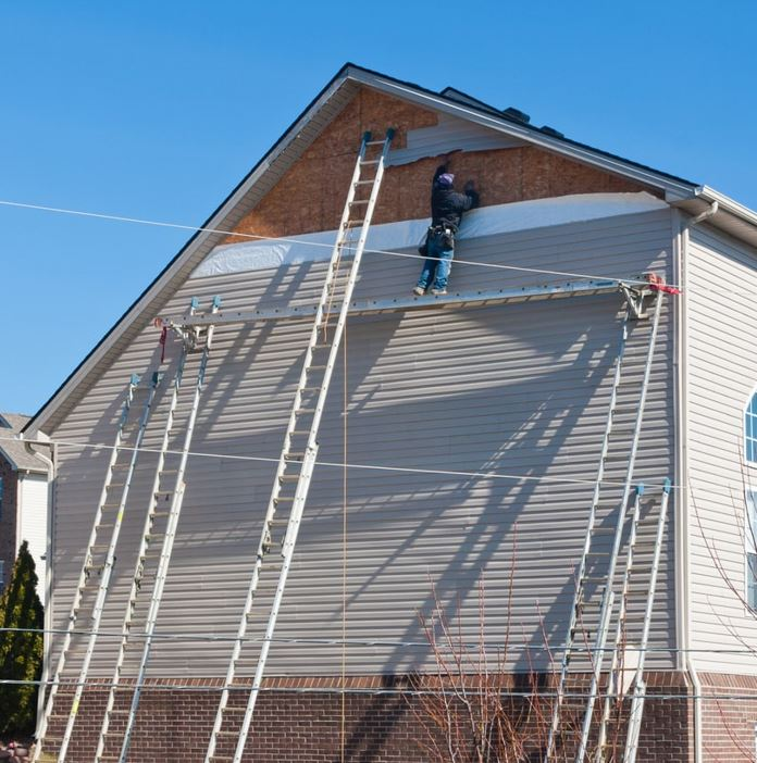 A professional composite siding installation company offers proper siding services.